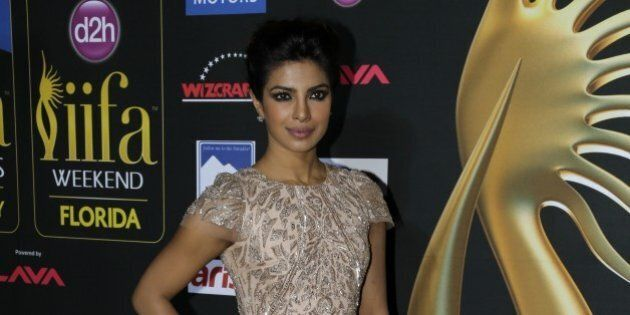 Indian film star Priyanka Chopra, poses for photographers as she walk the green carpet during the arrival...