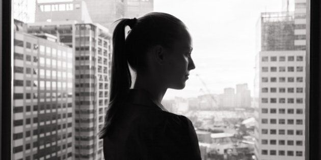 Thoughtful young business woman (black and white