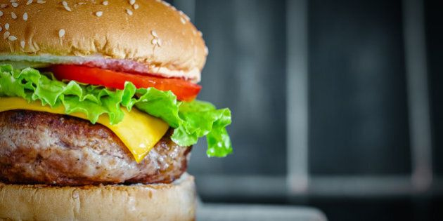 Tasty grilled beef Burger on wood background