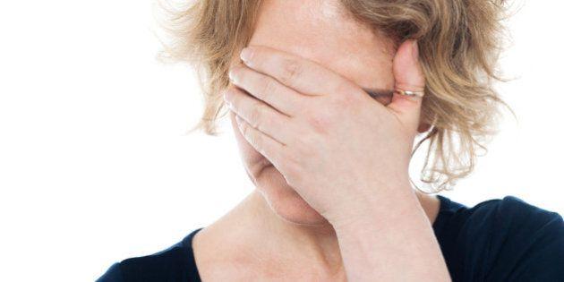 unhappy woman hiding her face...