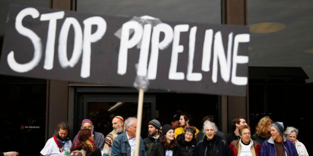 Protesters demonstrating in opposition to the proposed Keystone XL oil pipeline, Monday, March 10, 2014,...