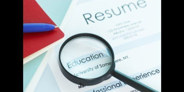 A magnifying glass on a resume magnifying the education section of the resume. Ideal image for job search and education themes. ++Note: University of Somewhere is a generic fictitious university name++