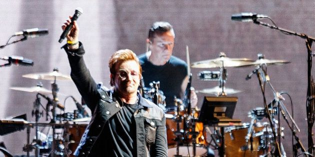 VANCOUVER, BC - MAY 12: (L-R) Bono and Larry Mullen Jr. of rock band U2 perform on stage during their...