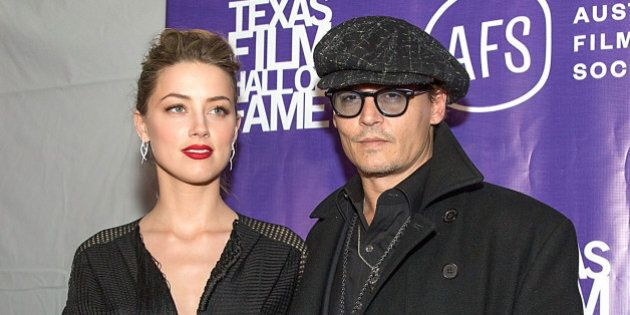 AUSTIN, TX - MARCH 06: Actors Amber Heard and Johnny Depp arrive at The Texas Film Hall Of Fame Awards...