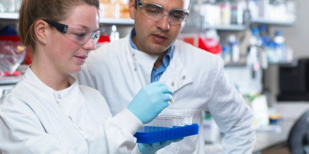 Scientists preparing to analyse samples from clinical trial, Jenner Institute, Oxford