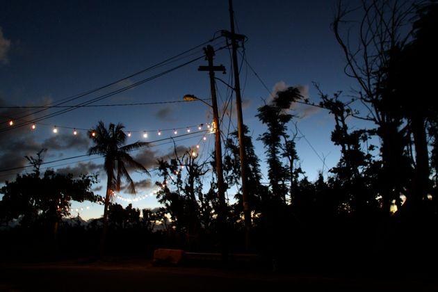 Lights powered by a generator hang over a street in Vieques on Nov. 26, 2017, two months after Hurricane...