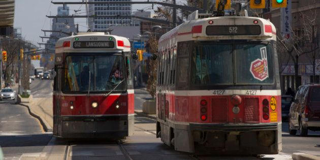 TORONTO, ON - APRIL 2: Lansdowne 512 streetcars pass each other at Wychwood Ave and St. Clair Avenue. TTC stats suggest that the St. Clair right of way for streetcars has improved ridership and cut transit trip times. April 2, 2014.        (Chris So/Toronto Star via Getty Images)