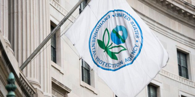 UNITED STATES - APRIL 22: A flag hangs over an entrance to the Environmental Protection Agency in Washington...