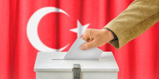 Man putting a ballot into a voting box - Turkey