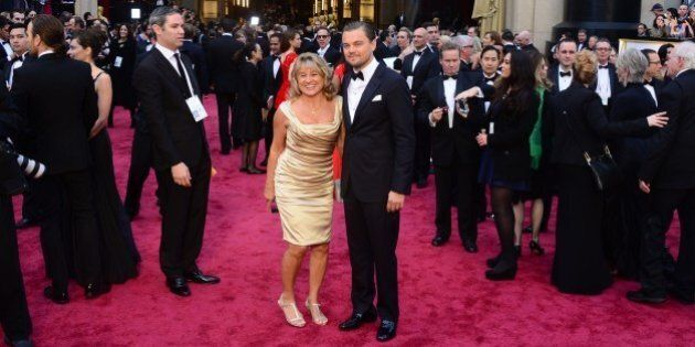 Nominee for Best Actor in 'The Wolf of Wall Street' Leonardo DiCaprio arrives with his mother Irmelin for the 86th Academy Awards on March 2nd, 2014 in Hollywood, California. AFP PHOTO FREDERIC J. BROWN        (Photo credit should read FREDERIC J. BROWN/AFP/Getty Images)
