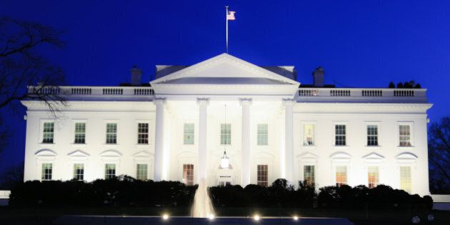The White House in Washington, D.C. is seen after sunset as darkness falls. It is the home of the first family of the president of the United States of America.