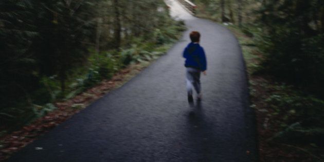 Boy Running Down Rural Road