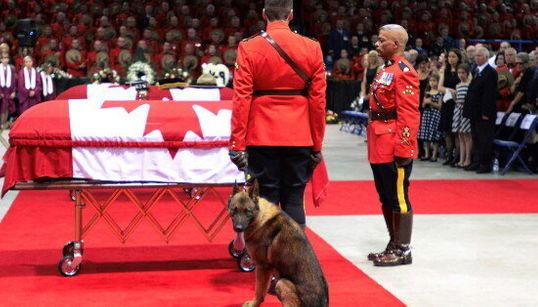 Fallen Mountie's Dog Cries At Foot Of