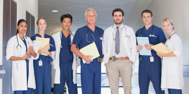 Portrait of confident doctors and nurses in hospital