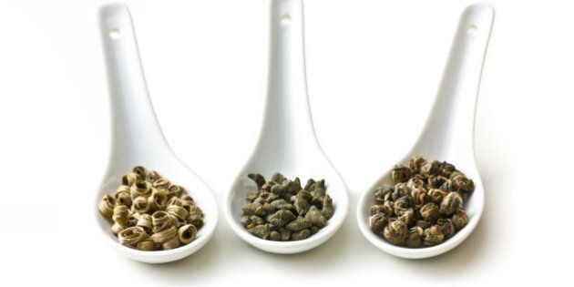 dry leaves of green tea in...