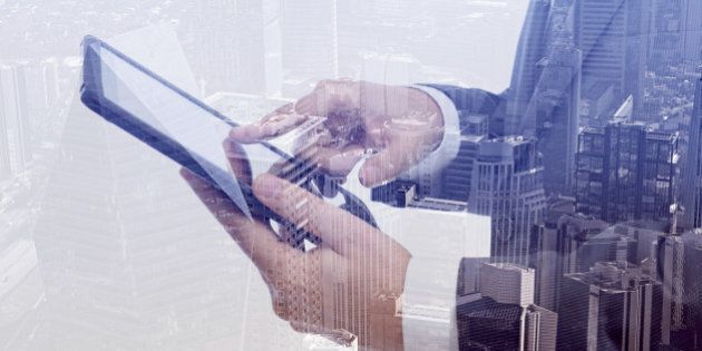 Double exposure of businessman and cityscape. Business & technology concept.