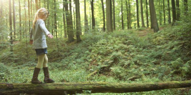 Girl walking on a tree