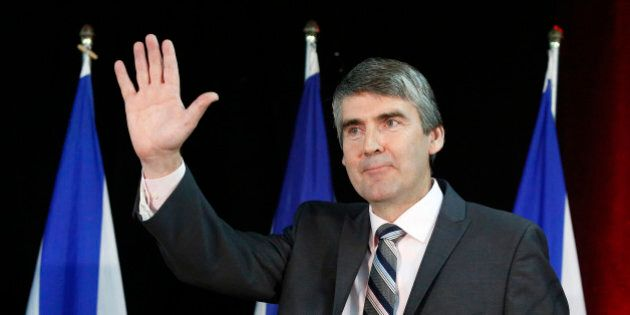 Nova Scotia Liberal Party leader Stephen McNeil waves to supporters after his majority election win in...