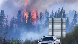 Wildfire Slows Rampage, But It's Too Soon To Celebrate: