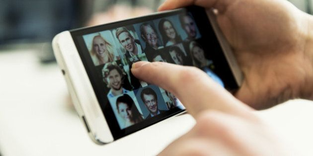Mobile phone full of small portrait photos. Concept of social networking.