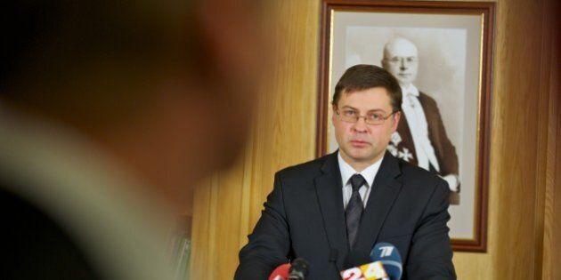 Latvian Prime Minister Valdis Dombrovskis give a press conference after resigning on November 27, 2013...