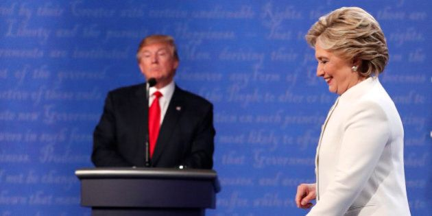 Democratic U.S. presidential nominee Hillary Clinton walks off the debate stage as Republican U.S. presidential...
