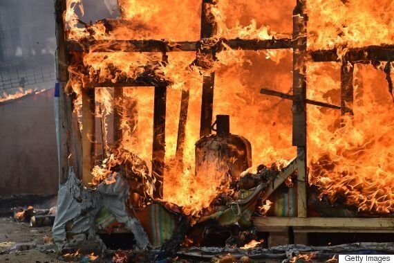 Calais Migrant Camp Set On Fire During