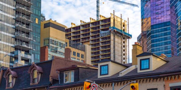 TORONTO, ONTARIO, CANADA - 2016/06/04: Contruction boom in real estate market. The housing market is...