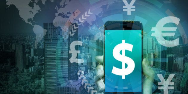 smart phone and financial technology (FinTech), US dollar and key currency symbols, worldwide trading,...