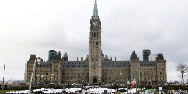 People participate in the The 100% Possible Climate March on Parliament Hill in Ottawa, on November 29, 2015. Some 150 leaders, including US President Barack Obama, China's Xi Jinping, India's Narendra Modi and Russian President Vladimir Putin, will attend the start of the Paris conference, which is tasked with reaching the first truly universal climate pact, with the goal to limit average global warming to two degrees Celsius (3.6 degrees Fahrenheit), perhaps less, over pre-Industrial Revolution levels by curbing fossil fuel emissions blamed for climate change.     AFP PHOTO/PATRICK DOYLE / AFP / PATRICK DOYLE        (Photo credit should read PATRICK DOYLE/AFP/Getty Images)