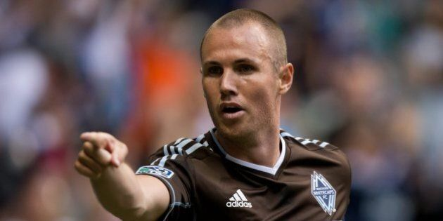 Vancouver Whitecaps' Kenny Miller, of Scotland, celebrates after scoring a goal against the New England...