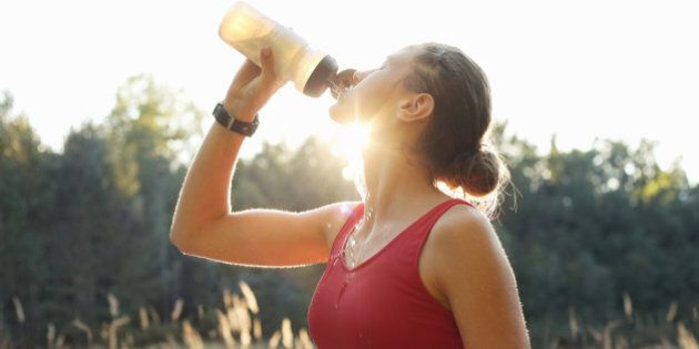 Female athlete rehydrating after training