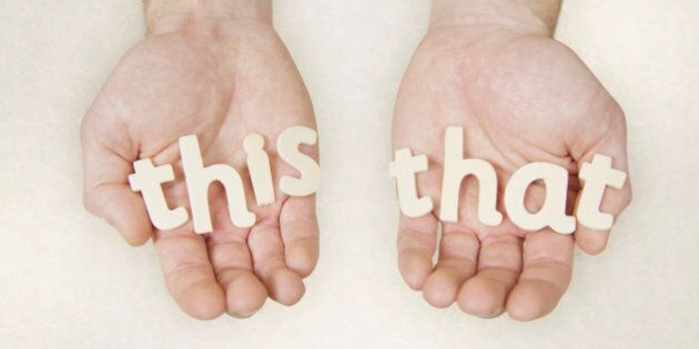 hands holding wooden letters spelling