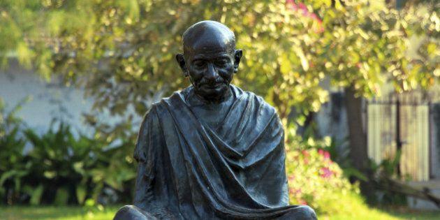 Sitting posture statue of Mahatma Gandhi at Sabarmathi Ashram, Ahmedabad, Gujarath, India,