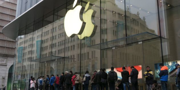 SHANGHAI, CHINA - MARCH 31: (CHINA OUT) Citizens queue up outside an Apple Store as Apple launches its...