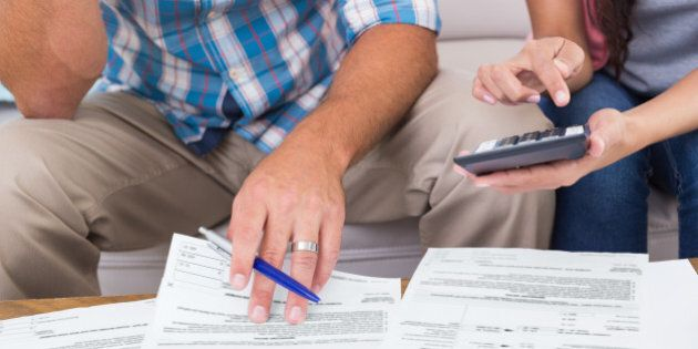 Cropped image of couple calculating finances at home