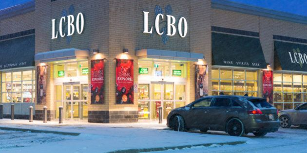 TORONTO, ONTARIO, CANADA - 2015/02/07: LCBO during a snowstorm, The Liquor Control Board of Ontario is...