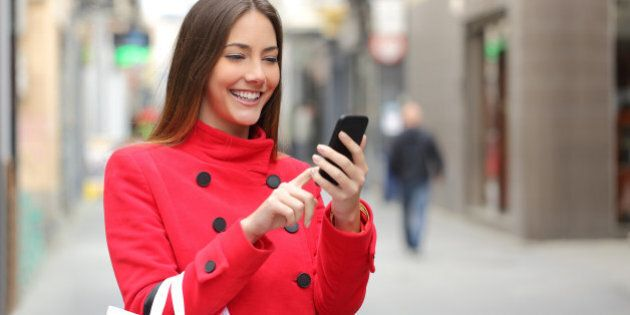 Shopper woman buying online on the smart phone in the