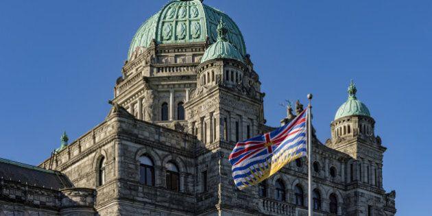British Columbia Parliament Building BC Flag Victoria BC Canada on a against a blue