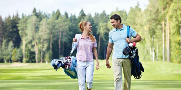 young couple on the golf