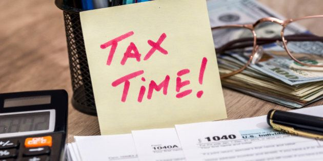 tax form with calculator, money and