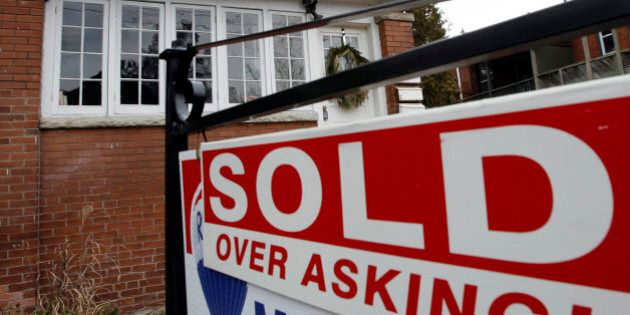 A sold sign is displayed in front of a home in Toronto December 15, 2009. A red-hot housing market fueled...