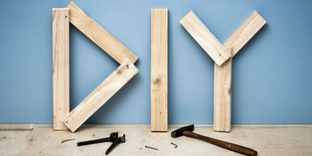 Wooden planks forming the letters DIY for 'Do It