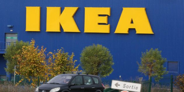 A car is driven past the IKEA store in Plaisir, west of Paris, Wednesday Nov. 20, 2013. Officials say senior executives of IKEA France are in police custody, over allegations that they illegally spied on employees and customers.(AP Photo/Remy de la Mauviniere)