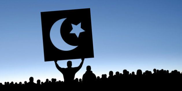 arab spring protestors in silhouette with crescent moon and star sign, panoramic frame