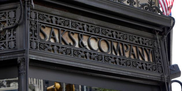 An ironwork logo adorns the facade of Saks flagship store on New York's Fifth Avenue, Monday, July 29,...