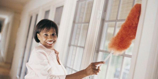Woman Dusting Windows of Domestic