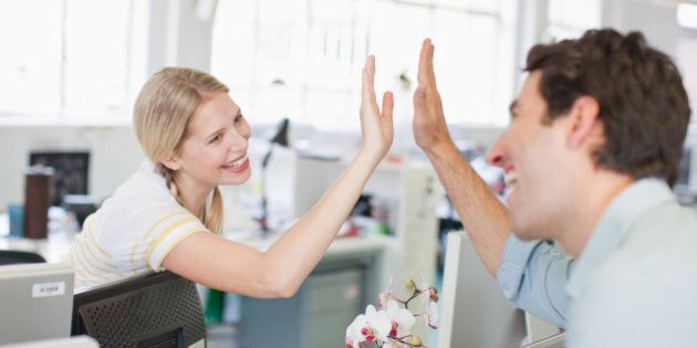 Business people giving high five in