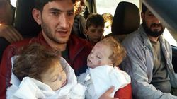'Say Goodbye, Baby': Syrian Father Parts With Twins Killed In