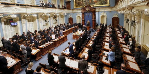 Members of the National Assembly (MNA) hold a minute of silence during a tribute to late former Quebec's...